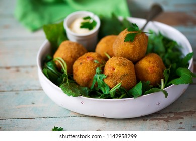 potato croquettes with mortadella. style rustic. selective focus