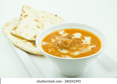 potato curry or aalu masala or aaloo masala with green peas, served with indian bread / roti / chapati / naan / fulka / phulka