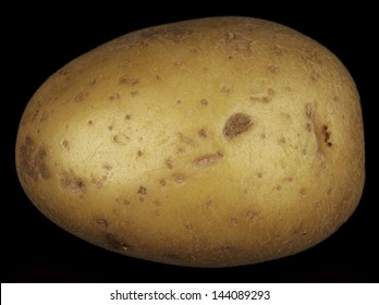 potato isolated on black