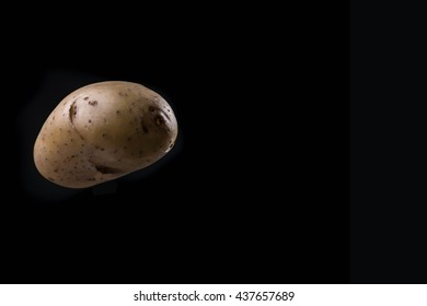 potato on black background