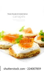 Potato Pancake and Smoked Salmon Canapes against a white background.