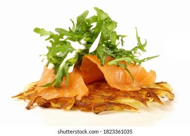 Potato Pancake with Smoked Salmon and Rocket Salad isolated on white Background
