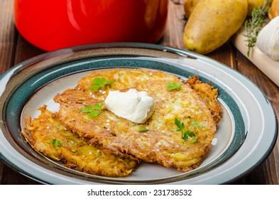 Potato pancakes homemade, garlic, creame fresh up and herbs from garden