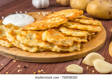 potato pancakes on a wooden background, natural products