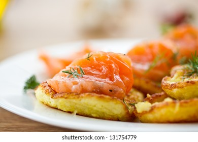 potato pancakes with salted salmon and greens