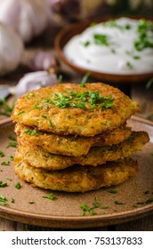 Potato pancakes with sour cream, herbs and garlic in