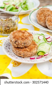 Potato and Pork Patties with Fresh Cucumber and Radish Salad, copy space for your text