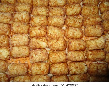 Potato Puff Casserole Preparation Adding Frozen Layer of Potato Puffs