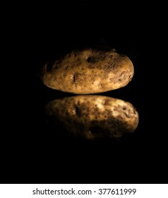 potato with reflection on the black background