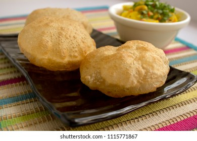 Potato sagu is a typical South Indian breakfast gravy. Potatoes are lightly spiced and served with puri.