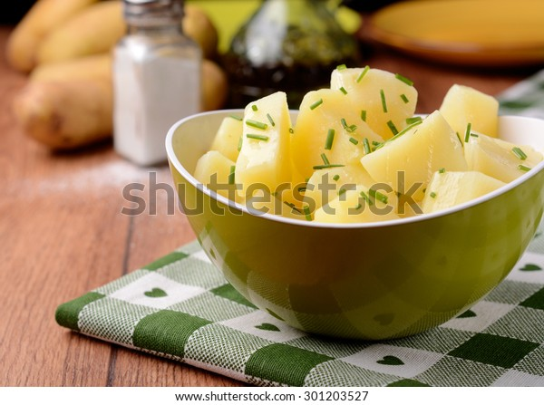 potato salad and chives in green bowl