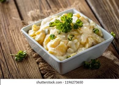 Potato salad with yoghurt and mayonnaise dressing with chives