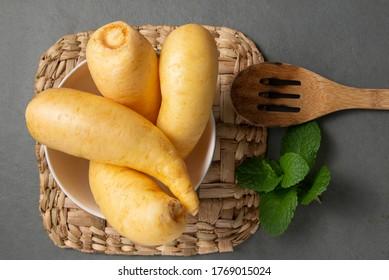 Potato salsa or baroa potatoes in the ceramic bowl. Top view