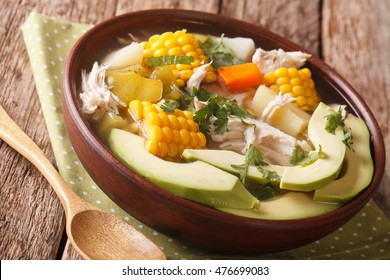 Potato soup ajiaco with chicken close up in a bowl on the table. horizontal