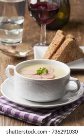 potato soup with slices of frankfurter