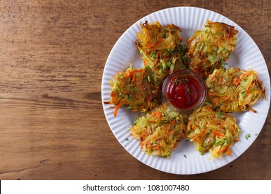 Potato Zucchini and Carrot Pancakes. Vegetable fritters, latkes, draniki. Vegetable cakes. View from above, top