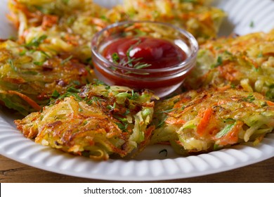 Potato Zucchini and Carrot Pancakes. Vegetable fritters, latkes, draniki. Vegetable cakes