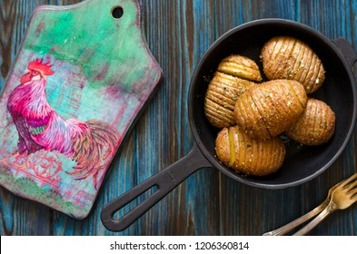 Potatoes baked in the oven in a cast iron pan
