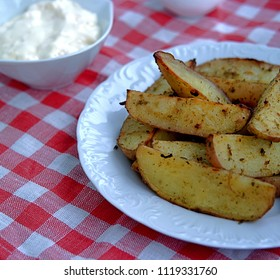 Potatoes baked with slices of spices. Served with cheese-garlic sauce