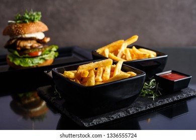 Potatoes fries in the plate on black background.