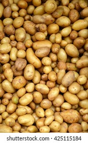Potatoes on market. Vegetables background.