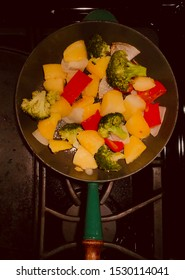 Potatoes, red pepper and broccoli in a frying pan