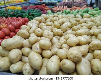 potatoes for sale in supermarket in hortifruti section, with background blur