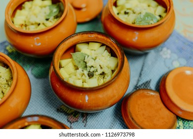 Potatoes with vegetables cooked on a pot in a pot