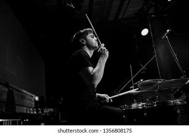 Potchefstroom, North West, South Africa, 01 31 2019, band live on stage performing rock at music festival. Die Heuwels Fantasties, drummer Sheldon Yoko