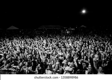Potchefstroom, north west, South Africa 02 01 2019 festival show crowd audience in black and white with hands in the air screaming, laughing and dancing
