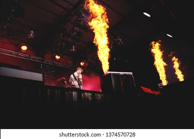 Potchefstroom, North West, South Africa 01292016 Zebra and Giraffe performing live on stage at a rock festival in front of audience fire pyro flames