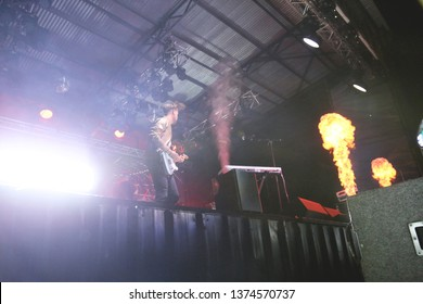 Potchefstroom, North West, South Africa 01292016 Zebra and Giraffe performing live on stage at a rock festival in front of audience with fire flames pyro