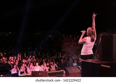 Potchefstroom, North West South Africa 02012013 Goodluck performing live on stage at rag festival Juliet hand in the air with crowd