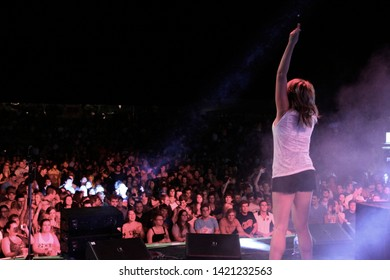 Potchefstroom, North West South Africa 02012013 Goodluck performing live on stage at rag festival hand in the air with crowd