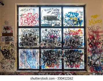 POTENZA, ITALY - MARCH 13, 2015: vandalized  urban wall with  tags and graffiti in Potenza, Italy. Potenza is the highest regional capital city in Italy.