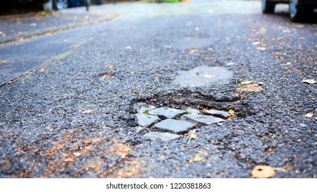 pothole and leaves on street