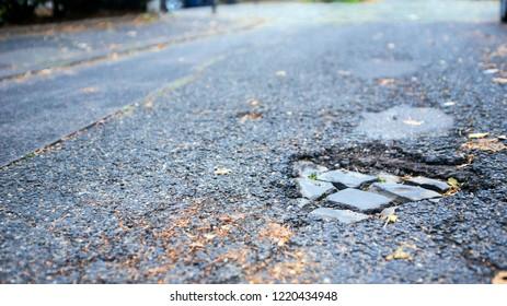 pothole on an empty street in germany