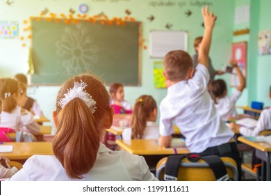 Poti, Georgia - 02.10.2018 - children actively participate in the class, read and listen to the teacher