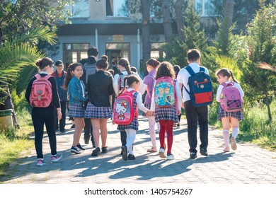 Poti, Georgia - 14.05.2019: Group of kids going to school together, back to school, education
