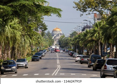 Poti town, Georgia. 31st July 2018. The main road to the center of the city. Palm trees and golden Orthodox Church.