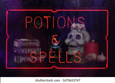 Potions and Spells Neon Sign in Rainy Window