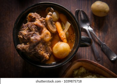 Potjiekos South African oxtail stew with baby gold potatoes carrots and button mushrooms
