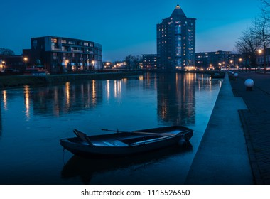 The potlood of Apeldoorn taken during blue hour with reflections and boat.
