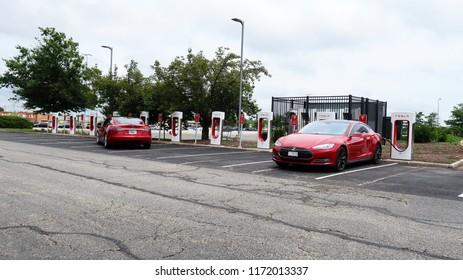 Potomac Mills, VA/USA-July 25, 2008:Two cars at a Tesla charging station
