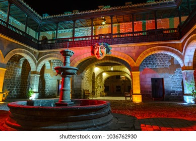 POTOSI, BOLIVIA - JULY 27: Courtyard with the mask of Bacchus in the National Mint of Bolivia on July 27, 2017 in Potosi, Bolivia
