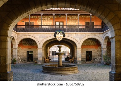 POTOSI, BOLIVIA - JULY 28: Courtyard with the mask of Bacchus in the National Mint of Bolivia on July 28, 2017 in Potosi, Bolivia