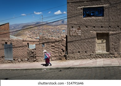 Potosi, Bolivia - November 29, 2013: Women wearing traditional clothes in the city of Potosi in Bolivia. Potosi is one of the highest cities in the world.