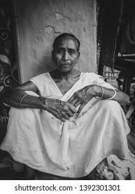 A potrait of a Assamese widow.