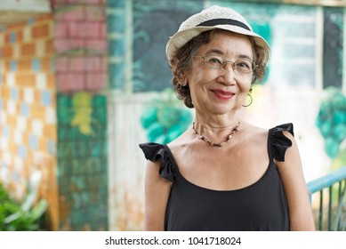 Potrait of a happy old asian woman.