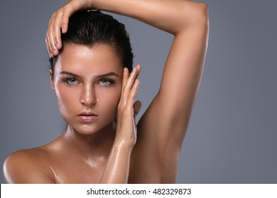 Potrait of young beautiful woman with oily and wet skin